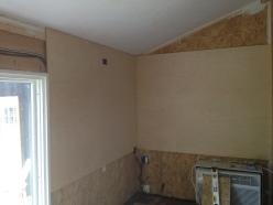 Finish grade plywood over SIP OSB (also may drywall- much easier and faster)